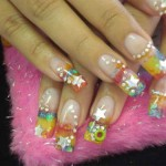 Дизайн ногтей «Радуга со звездой»