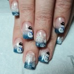 Дизайн ногтей со снеговиком